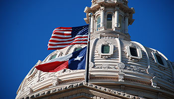 Texas capital with flags waving